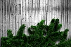Fir branches on wooden planks - stock illustration