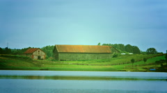 Large barn on the lake. Stock Footage