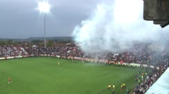 37. Football. Soccer. Stadium. Fans cheering on the stands. Pan left on the game Arkistovideo