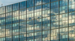 4K Clouds on glass Facade - DSLR timelapse Stock Footage