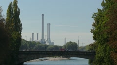 4K UHD Bridge Traffic Munich background is the Heating Plant at Munich South Stock Footage