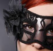 Red head woman wearing mask Stock Photos
