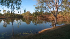 Early morning lake reflections in outback Australia Stock Footage