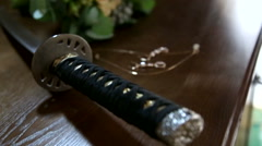 Samurai katana and the bridal bouquet. - stock footage