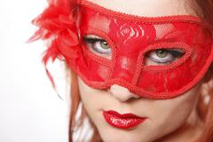 red head woman wearing mask - stock photo