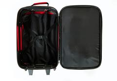 Stock Photo of baggage: opened and empty red suitcase isolated on white