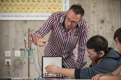 Vocational school student and teacher in chemistry class Stock Photos