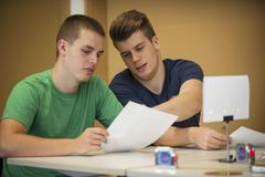 Two vocational school students in class room discussing Kuvituskuvat