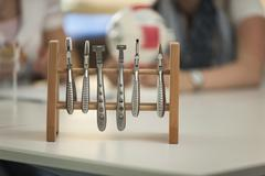 Optician's appliance and vocational school students - stock photo