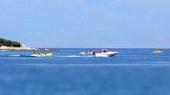 Happy people having summer fun on banana boat Stock Footage