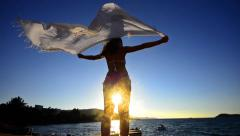 Silhouette of dancing woman sith scarf on the beach wind, inspiration,freedom Stock Footage