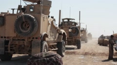 Afghan Man and Boy Walk Behind MRAP  (HD) Stock Footage