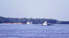 Two Barges Navigate Traffic on the Mississippi River Stock Footage