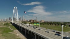 Dallas Skyline aerial flight towards landmark bridge Texas Flag - stock footage