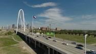 Stock Video Footage of Dallas Skyline aerial flight towards landmark bridge Texas Flag