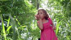 Little Girl Blows Dandelion Seed, Makes Wish, Then Closes Her Jar Of Wishes - stock footage