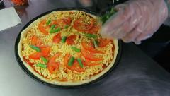 Chef puts green beans on pizza Stock Footage