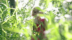 Little Girl Hides In Tall Grass, Camera Tries To Find Her. Slow Motion Stock Footage