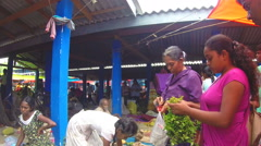 Woman buying vegetables at the local Sunday market in Sri Lanka. Stock Footage