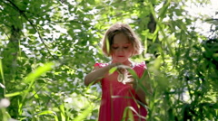 Little Girl Holds A Jar Full Of Wishes In A Green Forest Stock Footage