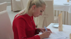 Young women is filling out a form Stock Footage
