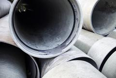 stack of new industrial pipes - stock photo