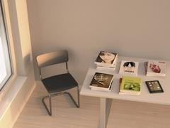 E-reader and books lying on a table, 3D Rendering Stock Illustration