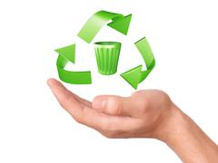 hand holding green recycling symbol - stock illustration