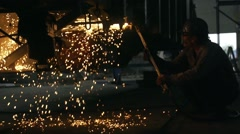 Hardworker cutting iron in factory and sprey sparkles Stock Footage