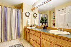 Bathroom interior with large vanity cabinet Stock Photos