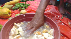 Hand washing sliced jack fruit slices in water bowl. Stock Footage