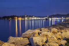 Slovenia, Slovene Littoral, Adriatic coast, Izola, Harbour in the evening - stock photo