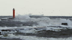 Autumn storm in Baltic sea at Mangalsala breakwater shot in slow motion. Stock Footage