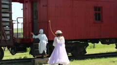 Girls in Western Era Clothing Enter a Vintage Train Cabin - stock footage