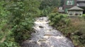 Wild river and traditional house in low mountain range Harz HD Footage