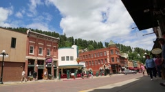 Low Angle View of Tourists on Deadwood Main Street Stock Footage