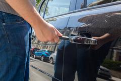 Man locking or unlocking a car door Stock Photos