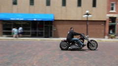 Motorcycle and Rider on Town Street Stock Footage