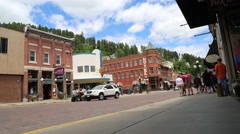 Tourists, Traffic, and an ATV on the Streets in Downtown Deadwood Stock Footage