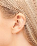 close up of woman's ear - stock photo