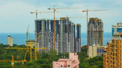 Construction timelapse with many high-rise cranes building a houses on a Black - stock footage