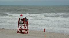Lifeguard stand in heavy wind on Atlantic Ocean beach Stock Footage