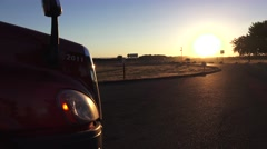 Big rig truck at sunrise, grill and highway traffic Stock Footage