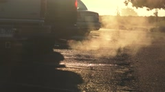 Warming the engine, tailpipe exhaust Stock Footage