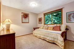 Comfort room interior with bed and pillows Stock Photos