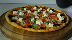 Pizzaiolo slicing pizza Stock Footage
