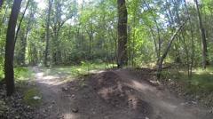 Mountain Bike Goes Off Jump Stock Footage