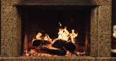 Slow motion fireplace burning. Warm cozy fireplace decorated for Christmas  Stock Footage