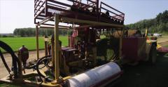 Peat moss cutting machine large format - red Epic Stock Footage