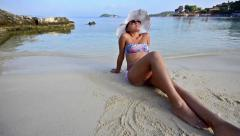 Summer concept, portrait girl with hat in bikini enjoying being alone by ocea Stock Footage